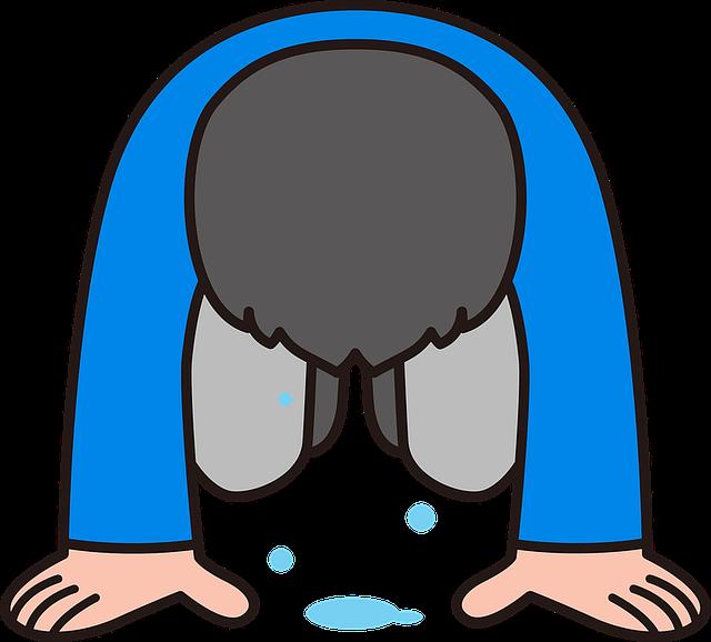 ストレスでうつ状態になる泣いている男性